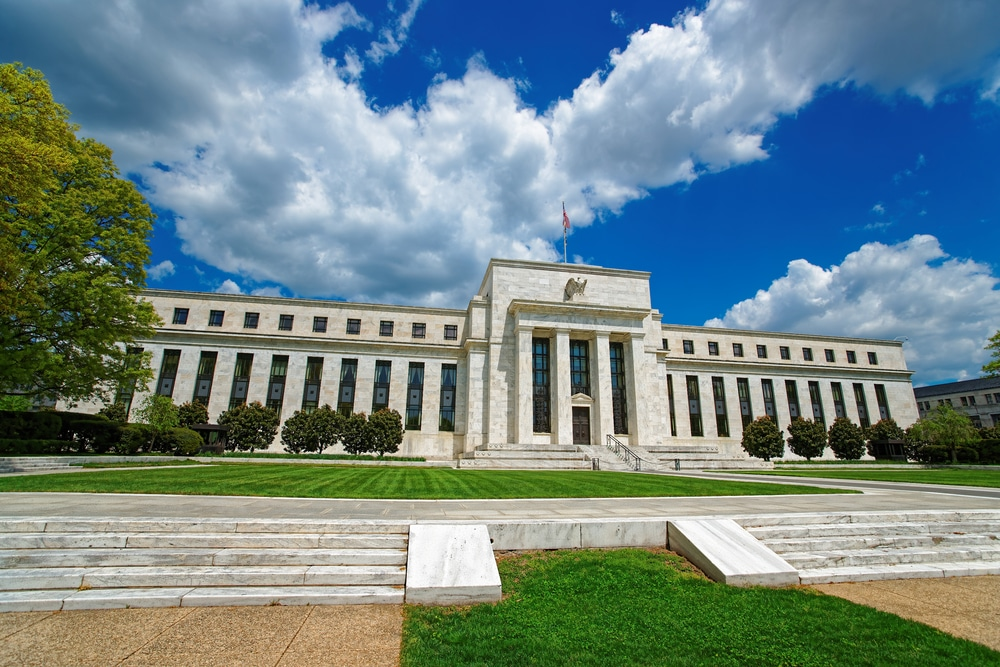 Fed Hints at Sooner-Than-Expected Reduction in Bond-Buying Program